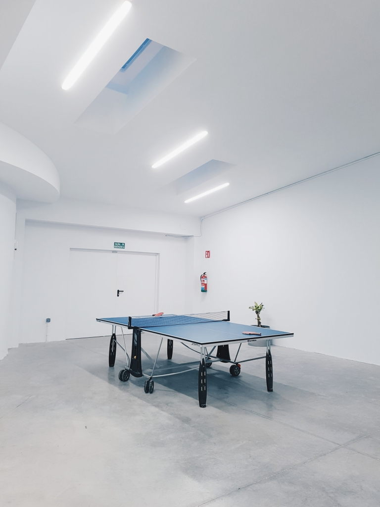 Fire extinguisher in a ping pong room